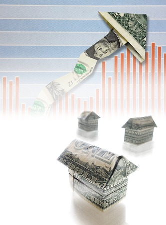 housing prices: Dollar homes and rising market chart  -- housing prices or mortgage interest rate concept Stock Photo