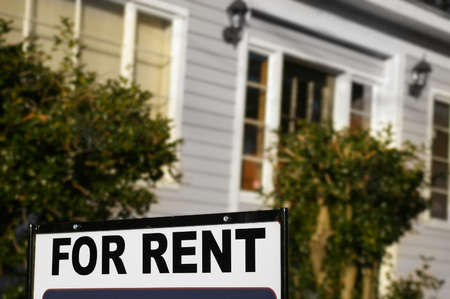 House  with For Rent sign in front Stock Photo