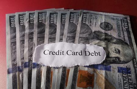 debt: Credit Card Debt message on hundred dollar bills