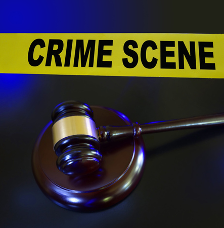 verdicts: Court gavel and crime scene tape with blue police lights Stock Photo