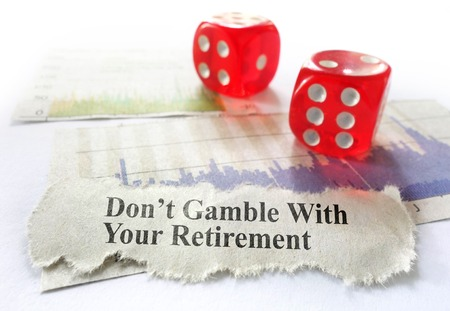 Dont Gamble With Your Retirement newspaper headline, with dice and stock market graphs