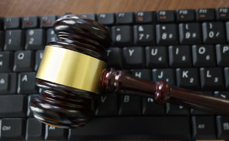 Judges court gavel on a computer keyboard