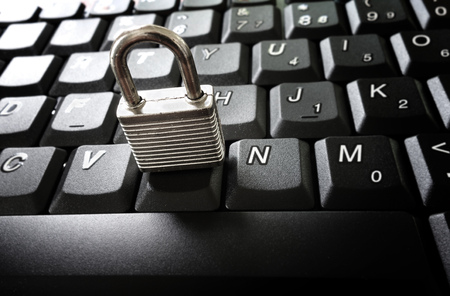 Small lock on computer keyboard -- data security concept 스톡 콘텐츠