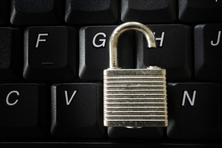 hacked: Broken lock on a computer keyboard -- data security concept Stock Photo