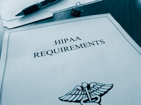 HIPAA requirements file on a desk