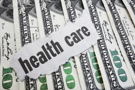 medical bill: Health Care newspaper headline on cash