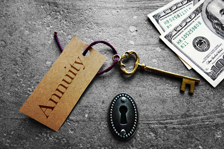 savings goals: Gold key with Annuity tag, with keyhole and cash