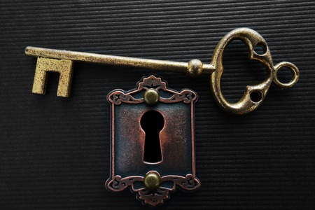 lock and key: Vintage gold key and old lock