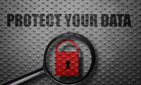 Red lock magnified with Protect Your Data text on metal background Stock Photo
