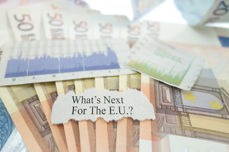 financial questions: What Next For the EU news headline on Euro notes with stock market graphs