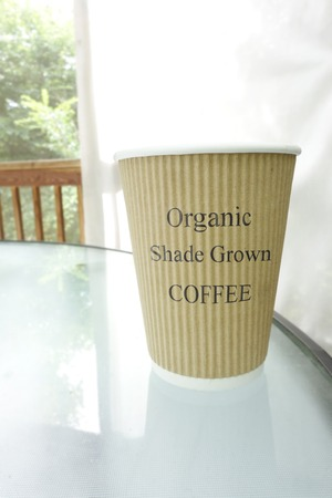 Coffee cup with Organic Shade Grown text Stok Fotoğraf