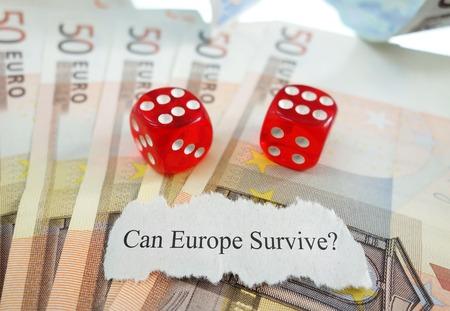 newspaper headline: Can Europe Survive newspaper headline with dice and money Stock Photo