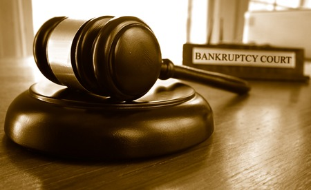 sue: Judges legal gavel in front of Bankruptcy Court nameplate