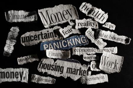 housing crisis: Newspaper economic headlines in sharp light on dark background Stock Photo