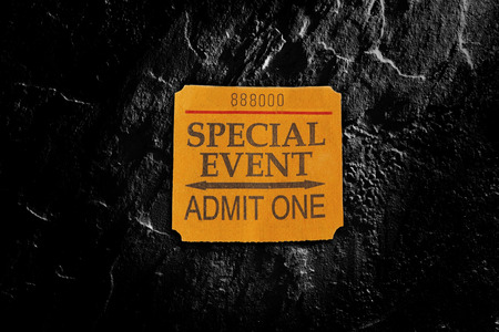 entertainment event: Special Event ticket stub in spotlight on textured  background
