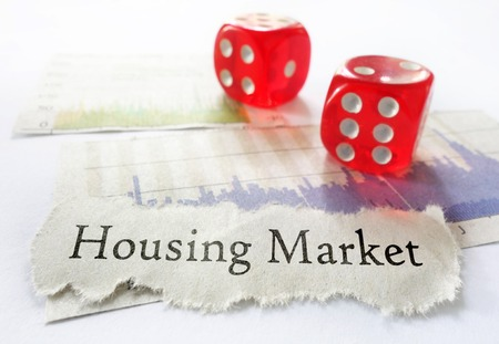housing market: Housing Market newspaper headline with dice and graphs