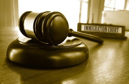 illegal immigrant: Judges legal gavel with Immigration Court placard Stock Photo