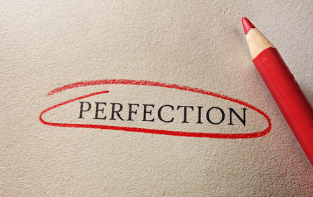 perfection: Perfection circled in red pencil, on textured paper