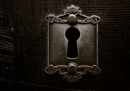 Old lock on a weathered wooden door Stock Photo