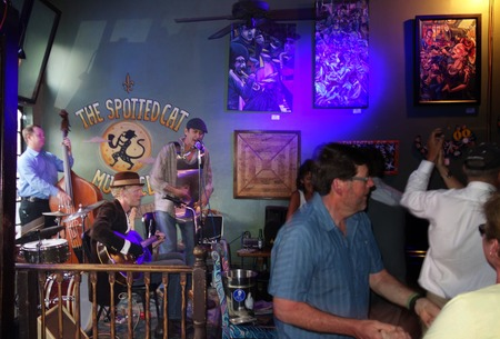 spotted: NEW ORLEANS,LAUSA -03-21-2014:Band playing at the Spotted Cat bar on Frenchmen St in New Orleans, Louisiana Editorial