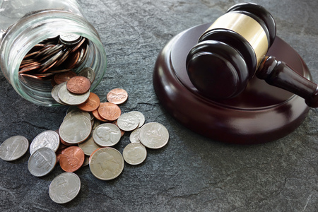 judgements: Coins from a coinjar and legal gavel