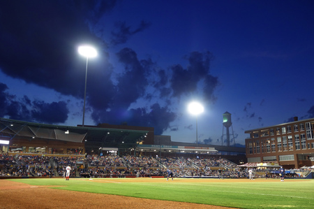 outfield: Professional minor league baseball stadium, night game outfield view