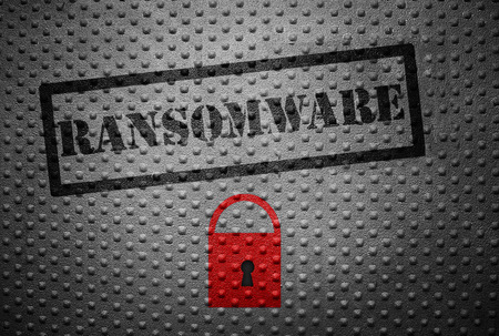 lock concept: Ransomware stamped on metal with red lock -- cyber crime concept Stock Photo