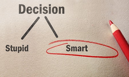 decision tree: Red circle and pencil on textured paper with Smart circled instead of Stupid