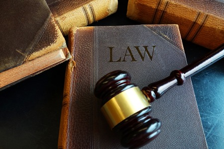 verdicts: Old law books and legal court gavel