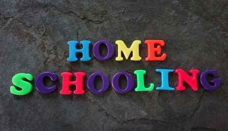 Home Schooling spelled out in colorful play letters Stock Photo