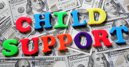 Child Support spelled in colorful play letters on cash