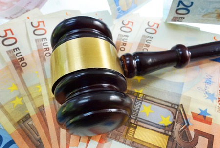 Court gavel on assorted Euro bills