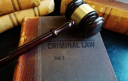 criminal case: Old Criminal Law books with court gavel Stock Photo