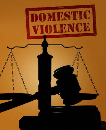 domestic: Court gavel and scales of justice silhouette with Domestic Violence text Stock Photo