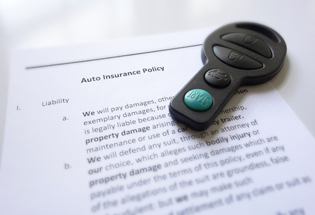 Auto insurance policy and car key Stock fotó