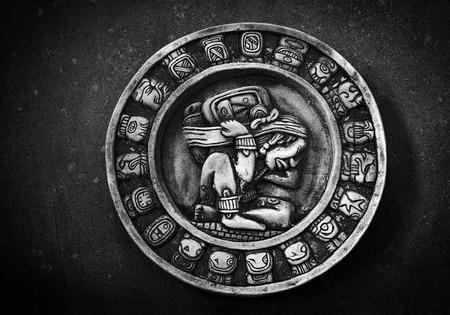 mayan calendar: Carved circular Mayan calendar on textured background Stock Photo