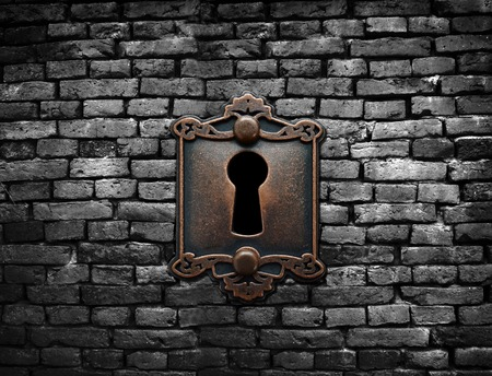 banned: Old fashioned metal lock on a brick wall Stock Photo