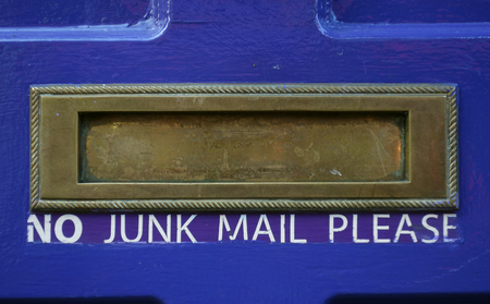Mail slot on a house door with No Junk Mail Please text Imagens