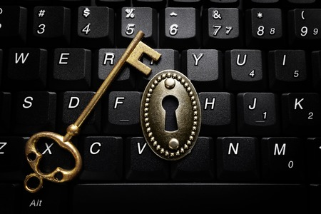 gold key: Vintage lock on a keyboard with gold key