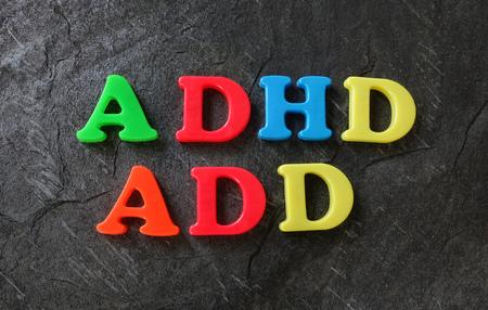 ADD en ADHD gespeld in kleurrijke spel letters Stockfoto