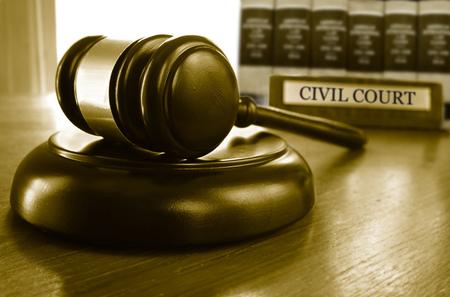 Judges Civil Court gavel on a desk with law books 版權商用圖片