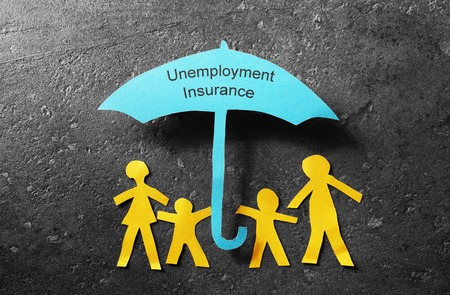 layoff: Paper cutout family of four under a blue Unemployment Insurance Stock Photo