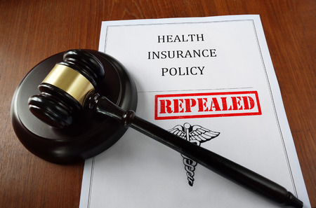 Health Insurance Policy document with court gavel and Repealed stamp Imagens