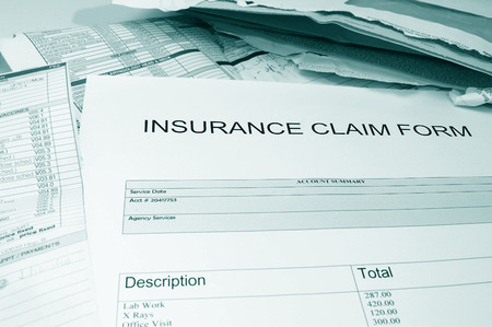 health insurance claim form, with assorted  medical bills Imagens