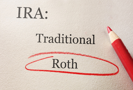 Traditional and Roth IRA circled in red pencil -- retirement concept Stock Photo