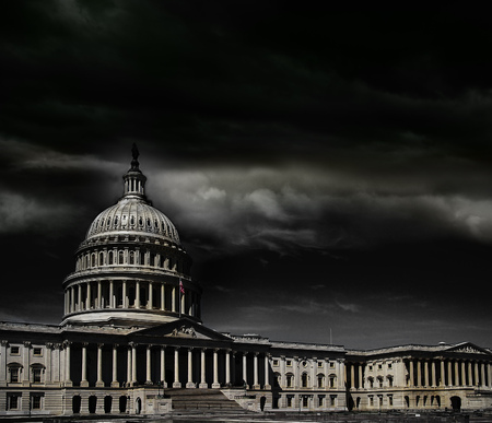 The United States capitol building with dark storm clouds above Stock Photo