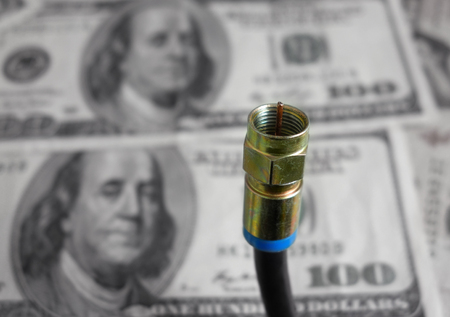 coax: Coax cable closeup with money in the background