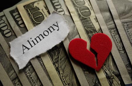 alimony: Broken heart with Alimony paper note on money Stock Photo