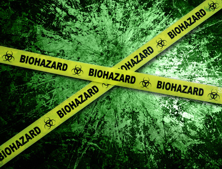 Yellow biohazard tape across and grunge green background