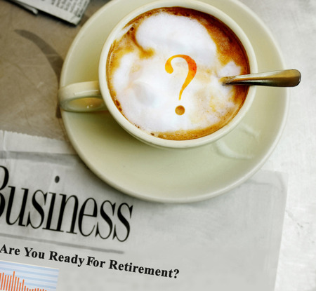 nestegg: Morning coffee with question mark and Retirement newspaper headline Stock Photo
